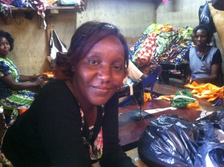 Cathrine Wangari Mowangi with her three employees in the Gikonga market