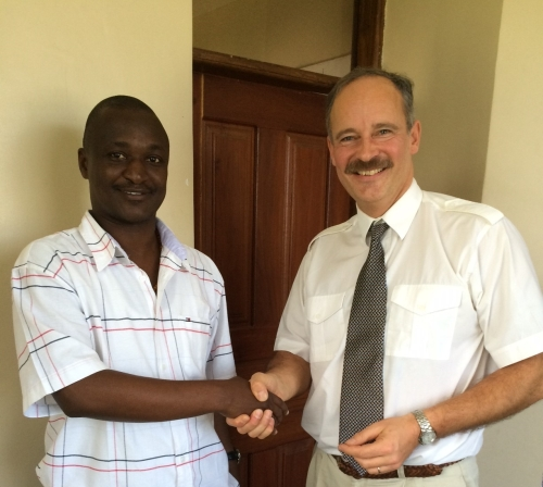 Damas Massawe, MD Mtaji Credit Facility (Left), Jes Colding, COO, MYC4 (Right) after signing the repayment agreement at Mtaji offices, Tanzania on 28th January 2015.