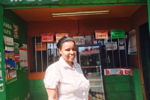 Elizabeth, a MYC4 borrower at her Mpesa shop.